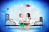 stock photo of sweet dreams  - Cute kids sitting together on the bed under the blanket - JPG