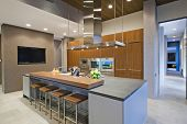 stock photo of spotlight  - Bar stools at breakfast bar in contemporary kitchen - JPG