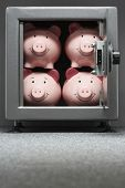 Four piggy banks in safe
