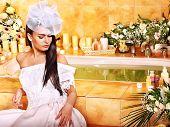 Woman wearing wedding dress at spa.