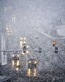 pic of snowy-road  - Snowy winter road with cars driving on roadway in snow storm - JPG