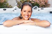 stock photo of sauna woman  - Beautiful woman relaxing in a hot tub - JPG