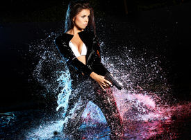 picture of raider  - beautiful sexy girl holding gun in water - JPG