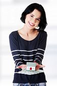 Happy woman holding polish zloty bills and house model over white - real estate loan concept