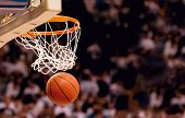 stock photo of bucket  - Scoring the winning points at a basketball game - JPG