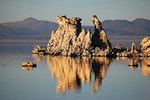 Magic sunset on Mono lake . Ancient lake in a crater of an extinct volcano. Tufa stalactites are ref