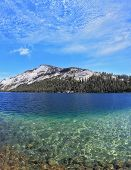 The majestic American nature. Blue shallow lake in a hollow among the mountains. Photo taken fisheye lens