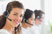 Portrait of beautiful businesswoman wearing headset in call center
