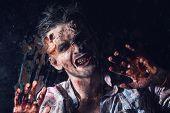 Creepy zombie behind the window