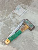 Awl And Hammer On Concrete Flooring