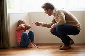 stock photo of argument  - Father Shouting At Young Daughter - JPG