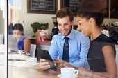 stock photo of nativity  - Businessman And Businesswoman Meeting In Coffee Shop - JPG
