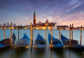 Gondolas on Saint Mark square with San Giorgio di Maggiore church in the background.  Venice, Venezi