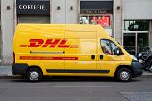VALENCIA, SPAIN - JANUARY 28, 2014: A DHL delivery van on the street in the city center of Valencia.