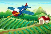 Crop dusting a farm with plane
