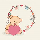 Happy Valentines Day concept with cute teddy bear holding heart shape on floral decorated frame on abstract brown background.