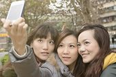 Asian women take picture by themselves.
