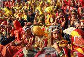 PUSHKAR, INDIA - NOVEMBER 21 2012: Group of Indian girls in colorful ethnic attire attends at Pushkar camel fair