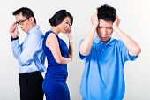 stock photo of disobedient  - Young Chinese boy suffering from fighting parents and their divorce - JPG