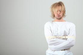 image of madman  - Mentally ill man in strait - JPG