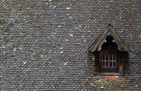 foto of gabled dormer window  - Old brown tile roof with dormer in european building - JPG