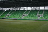 Soccer stadium with green tribune and field