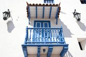 White blue balcony with lamps