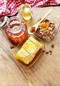 Fresh honey and healthy snack on wooden table