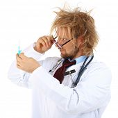 Funny doctor in glasses holding syringe isolated on white