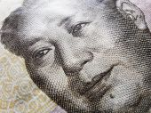 stock photo of zedong  - Extreme closeup of Mao Zedong in a Chinese Yuan banknote - JPG