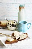 Dairy products: milk, butter, cottage cheese on wooden background