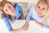 female business team agreeing contract