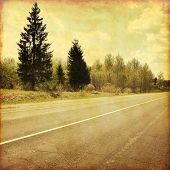 Country asphalt road in grunge and retro style.