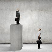 Conceptual image of businesswoman looking at man standing on bar