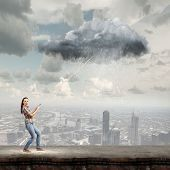 Young woman in casual holding cloud on lead