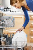 Woman Using Dishwasher