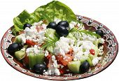 Fresh seasoned salad with tomatoes, cheese, cucumbers, olives and leaf salad.