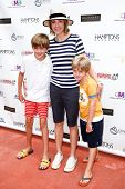 BRIDGEHAMPTON, NY-JUL 19: (L-R) William Lawrence, Christa Miller & Henry Lawrence attend the Annual