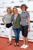 BRIDGEHAMPTON, NY-JUL 19: (L-R) Julie Bowen, Ali Wentworth and Christa Miller attend the 6th Annual Family Fair at Children's Museum of the East End (CMEE) on July 19, 2014 in Bridgehampton, New York.