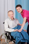 Disabled Man And A Nurse Smiling