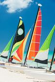 Colorful sailboats on a beautiful beach in Cuba