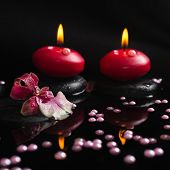 Spa Still Life Of Red Candles, Zen Stones With Drops, Orchid Cambria Flower And Pearl Beads On Refle