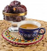 Ramadan eastern refreshment drink with dates on table placemat  isolated  on a white background