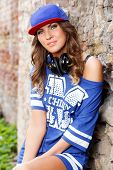 Outdoor, street. Attractive girl in the cap