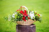 image of dowry  - Floral arrangement with strawberries in a basket on the grass - JPG
