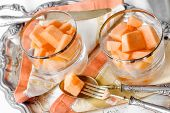 summer dessert with melon and water melon and vintage silverware
