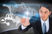 Businessman pointing to word phishing against futuristic technology interface
