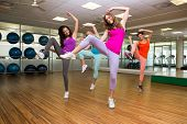 stock photo of zumba  - Zumba class dancing in studio at the gym - JPG
