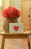 Vase basket with red tissue paper with love letter