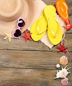 Few summer items on wooden background
